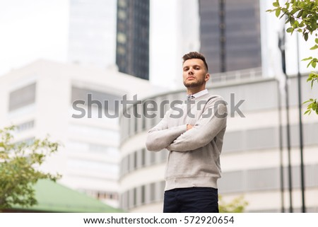 business and people concept - young man on city street #572920654