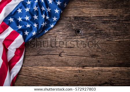 American flag on old wooden board.