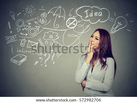 Portrait pensive young woman thinking has many ideas looking up isolated gray wall background. Human face expression emotion feeling life perception. Decision making process concept