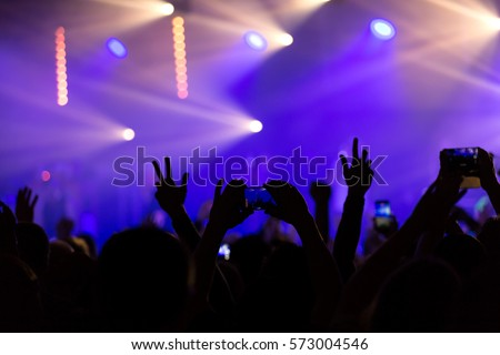 Crowd people with hands in the air at a music festival #573004546