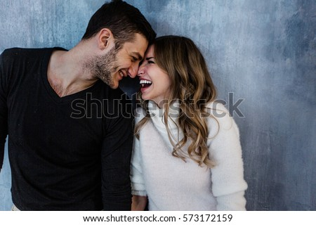 Young couple in love have fun i on new years eve or st valentines day Royalty-Free Stock Photo #573172159