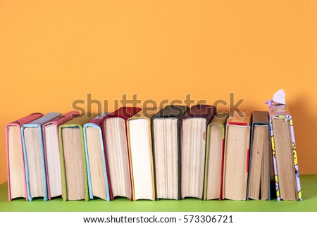Set of colored books on bright colorful background.free copy space. Back to school copy space. Education background. #573306721