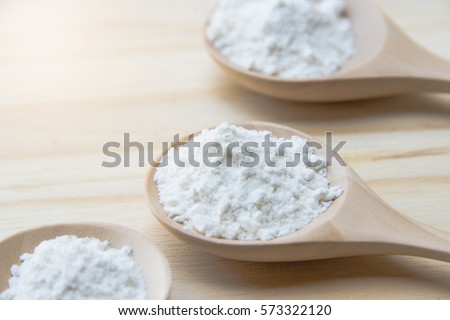 Powder in the wooden spoon #573322120
