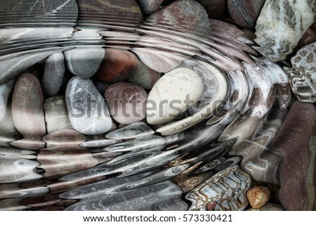 Water ripples over the stone pebbles - digitally altered #573330421