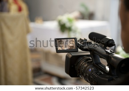 Cameraman recording video of a marriage