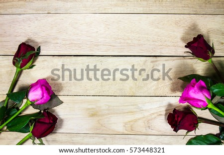 Red roses and a heart on wooden board, Valentines Day background #573448321