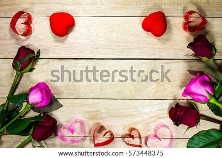 Valentine background with red rose flower, handmade paper hearts #573448375