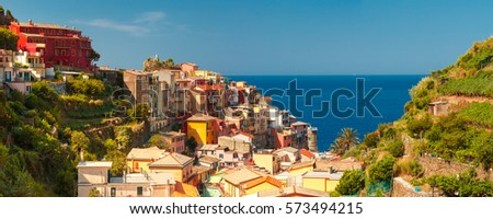 Aerial panoramic view of Manarola fishing village in Five lands, Cinque Terre National Park, Liguria, Italy. #573494215