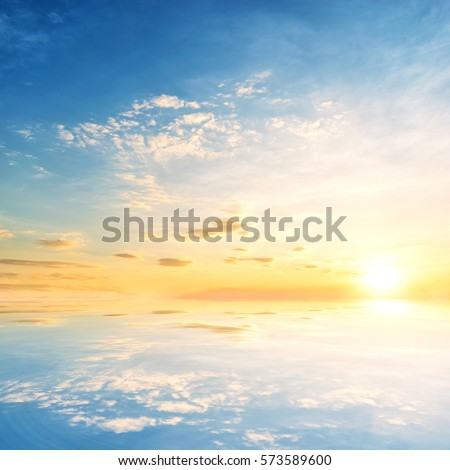 Background sky during sunset and water reflections. #573589600