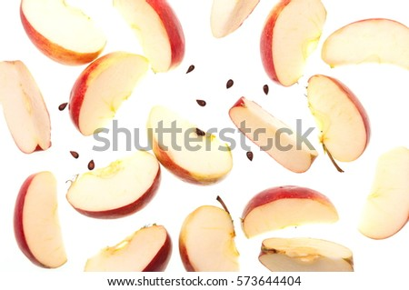 Slices of fresh red apple and seeds, isolated on white background, top view.  #573644404