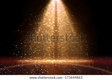 Stage light and golden glitter lights on floor. Abstract gold background for display your product. Spotlight realistic ray. Royalty-Free Stock Photo #573644863