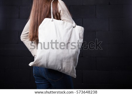 Woman holding an empty bag for logo #573648238