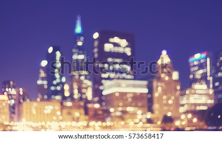 Color toned blurred picture of Chicago downtown at night, abstract urban background, USA.