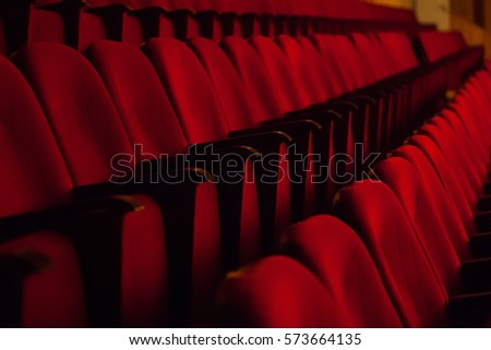 red chairs in the auditorium at the concert #573664135