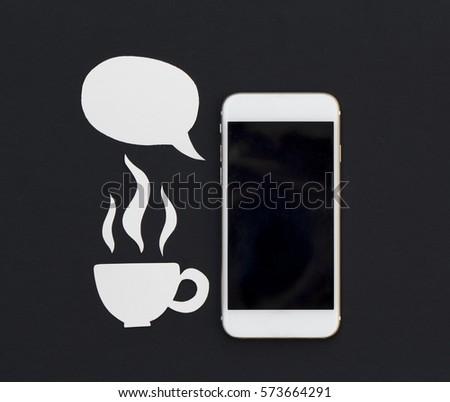 White phone and blank text bubble and hot drink cup. Breakfast with smartphone flat lay photo. Speaking cellphone banner template with text place. Black screen phone with speech bubble and tea cup