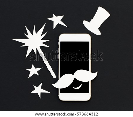 White phone in paper cut collage with magic wand and stars. Smartphone magician with mustache and vintage hat. Cellphone magical banner template with text place. Smiling phone flat lay photo on black