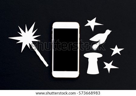White phone in paper cut collage with magic wand and stars. Smartphone with dove and vintage hat photo. Creative banner template with cellphone. Black and white flat lay composition with mobile phone