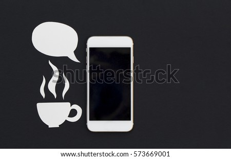 White phone with paper cut text bubble and hot coffee cup. Breakfast with smartphone flat lay photo. Speaking cellphone banner template with text place. Black screen phone with cartoon speech bubble