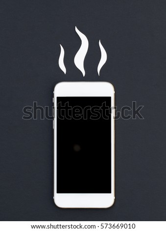 White phone and hot smoke paper cut. Smartphone flat lay mockup. Cellphone banner template with text place. Black screen phone top view. Break and repair phone photo. Hot news or message concept image