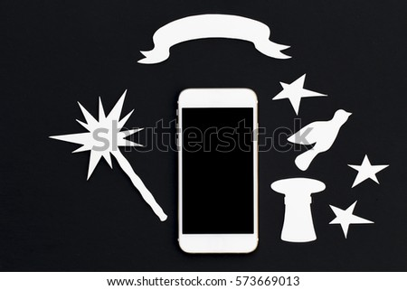 White phone with magic wand and banner. Smartphone with dove and vintage hat photo. Cellphone banner template with text place. Black and white flat lay composition with mobile phone and paper cut icon