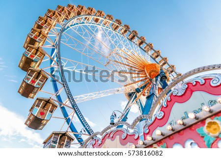 ferris wheel without people  at Oktoberfest in Munich Royalty-Free Stock Photo #573816082