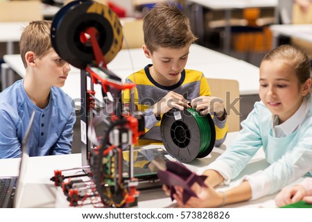 education, children, technology, science and people concept - group of happy kids with 3d printer at robotics school lesson Royalty-Free Stock Photo #573828826