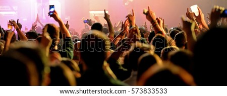 Crowd in a concert. Royalty-Free Stock Photo #573833533
