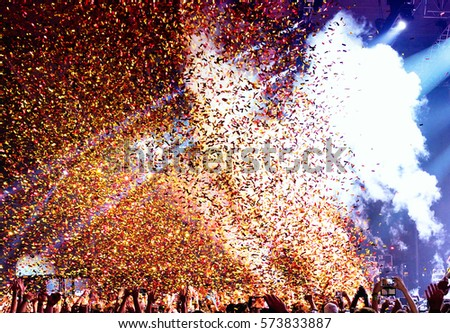 Confetti in a concert. Royalty-Free Stock Photo #573833887