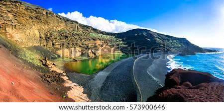 El Golfo with unique Lago Verde and black sands beach. Lanzarote, Canary islands Royalty-Free Stock Photo #573900646