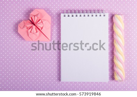 Heart origami, open notebook with a blank page and stick marshmallows on a background of polka dots. Copy spa?e. Valentine's Day #573919846