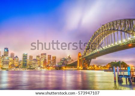 SYDNEY - OCTOBER 2015: Sydney Harbour Bridge. Sydney attracts 20 million tourists annually. #573947107