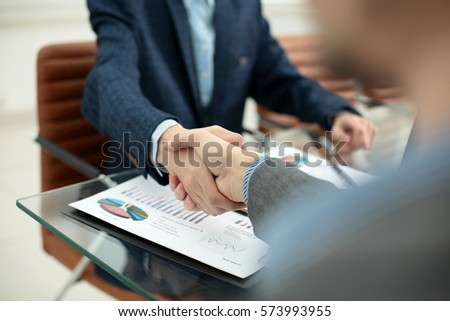 businessman shaking hands to seal a deal with his partner #573993955