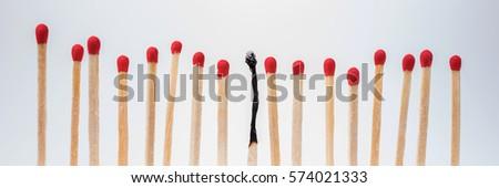 Burnt match between new matchsticks, shallow depth of field #574021333