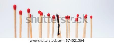 Burnt match between new matchsticks, shallow depth of field #574021354
