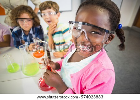 Kids doing a chemical experiment in laboratory at school #574023883