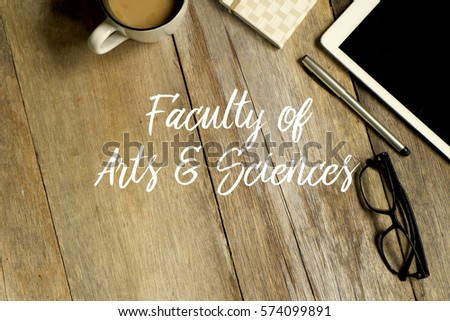 Education concept. Top view of tablet pc, glasses. notebook pen and a cup of coffee with FACULTY OF ART AND SCIENCES written on wooden background. #574099891