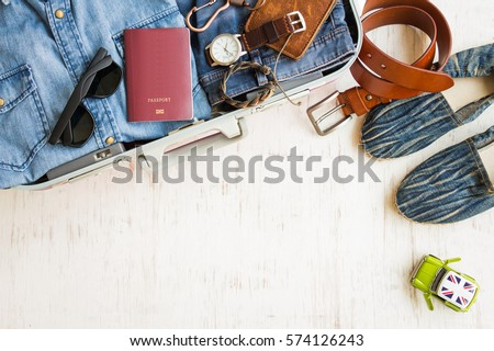 Travel preparations, men's casual outfits with accessories on white rustic wooden background #574126243