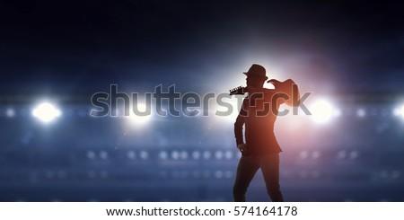 Elegant guitarist silhouette . Mixed media #574164178