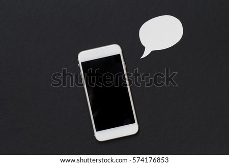 White phone with blank text bubble. Smartphone and cartoon style bubble. Cellphone banner template with text place. Black and white background with Iphone top view. Speech or message bubble and phone