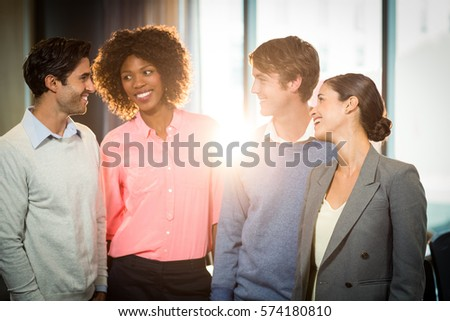 Business people having discussion with each other in office #574180810