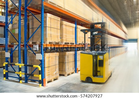 A yellow forklift at warehouse. #574207927