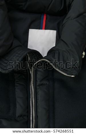 Tag on a Black Jacket #574268551