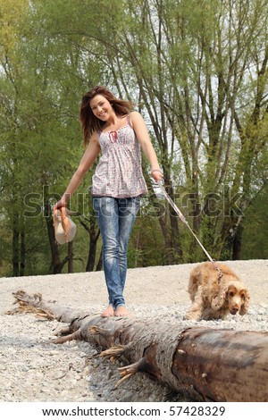 girl with dog in nature #57428329