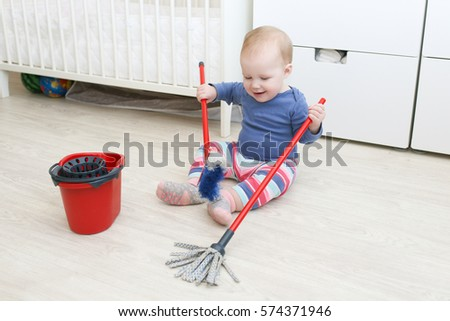 Little baby cleaning at home #574371946