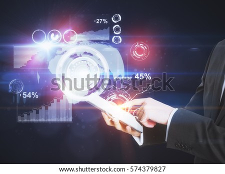Hands using tablet with abstract digital charts and diagrams. Business communications concept #574379827