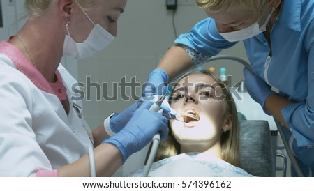 Patient for preventive medical checkup at dentist with probe and mirror #574396162