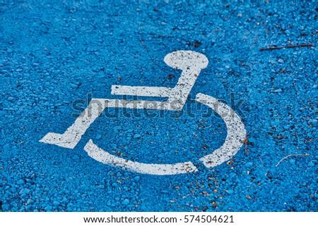 disabled sign painted on asphalt #574504621