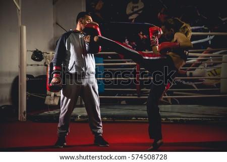 Woman kick-box, training kicks with her coach #574508728