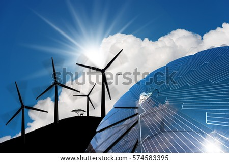 Detail of a solar panel in the shape of a flower with four silhouettes of wind turbines in mountain on a blue sky with clouds and sun rays