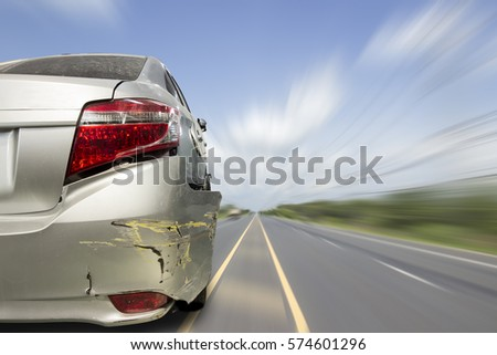 Car of accident make rear bumper cracked and airbag explosion damaged at claim the insurance company. Double exposure car accident and road on cityscape.  Image blur focus  style. #574601296